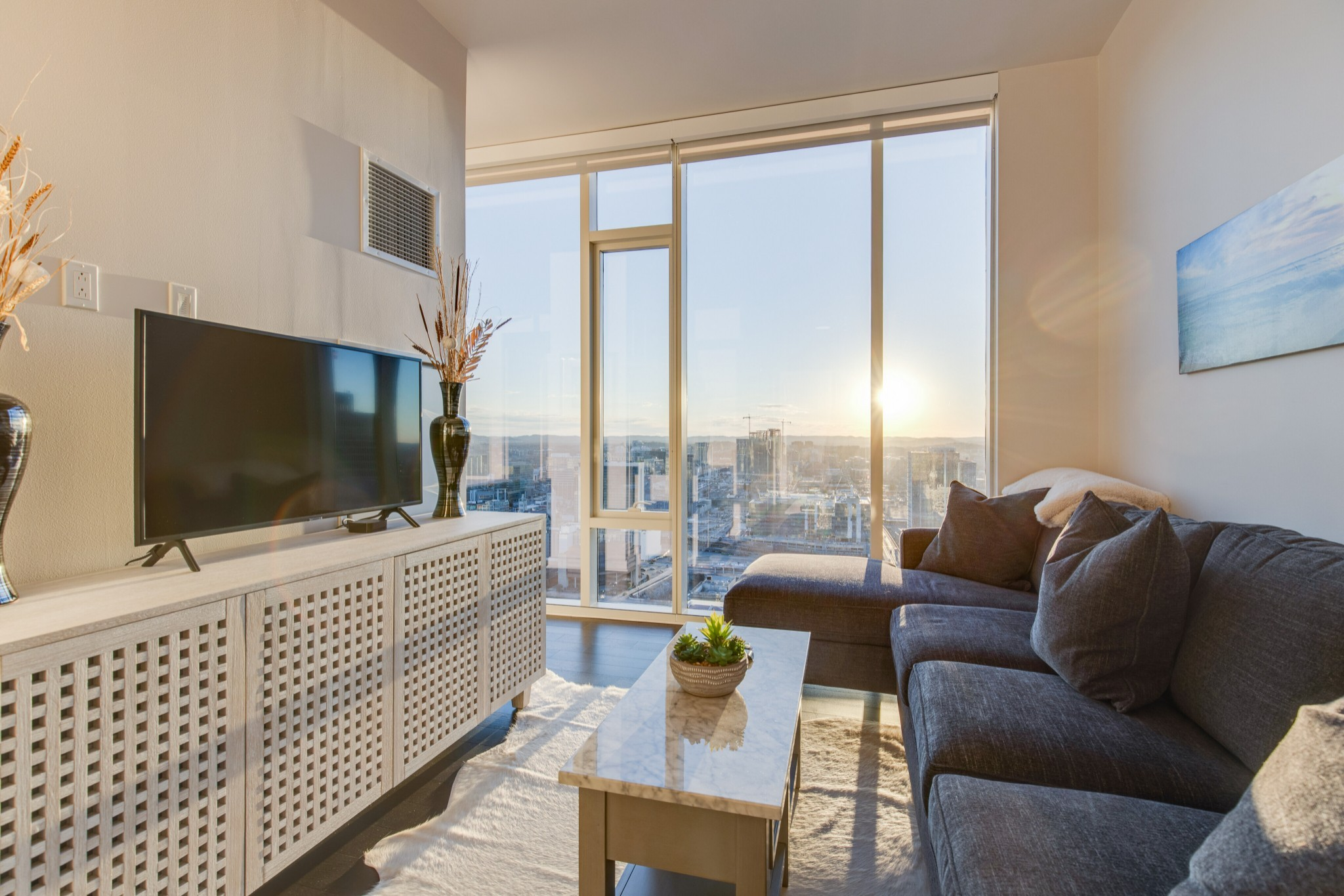 Furnishings and sunset views over the city included!